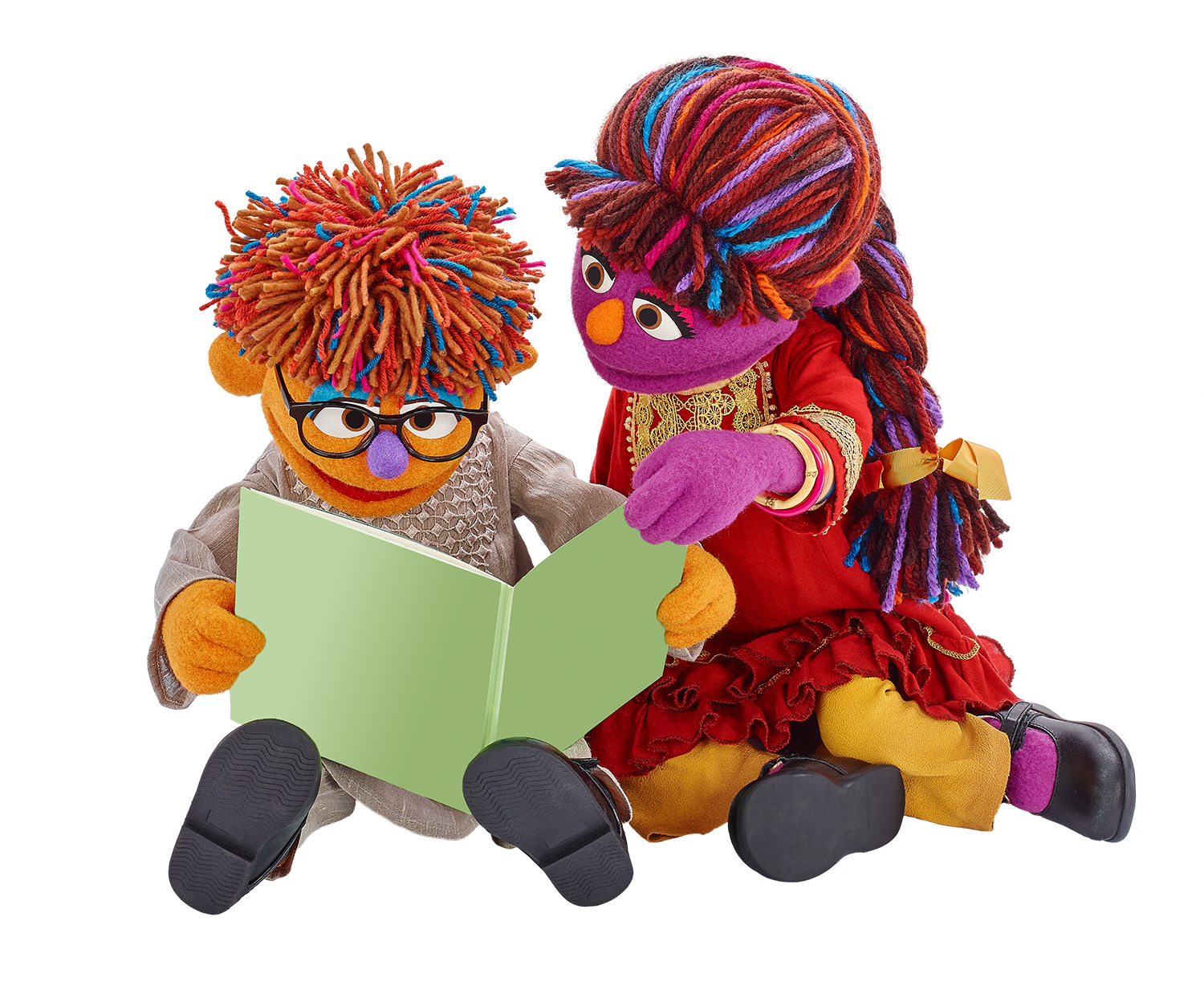 Zeerak sits with his older sister Zari. They're reading together.