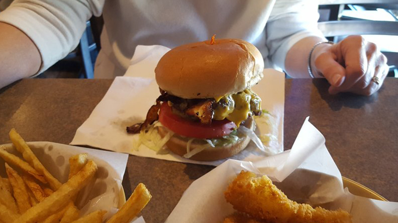 burger on a table at stellas diner